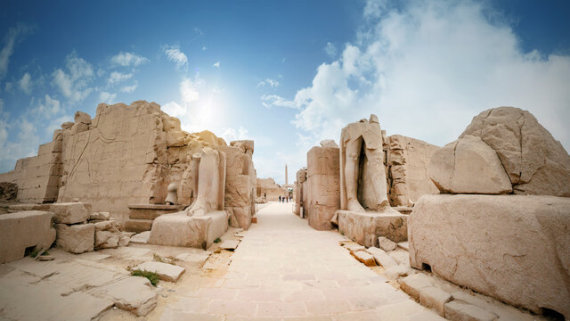 Alley with the ruins of statues and sanctuaries in the Karnak Temple of Luxor, Egypt.