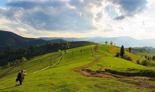 Photographers take pictures of spring rural landscape in the Mizhhiria, Carpathian mountains