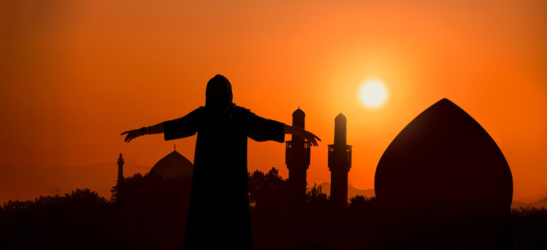 Happy Iranian girl's arms up with wearing abaya - Silhouette of Shah mosque at sunset - Isfahan, Iran
