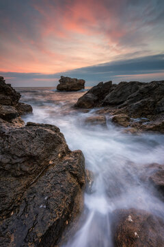 Stormy sea with beautiful morning sky at the rocky coastline of the Black Sea