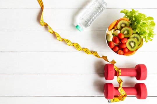 Diet Healthy food and lifestyle health concept. Sport exercise equipment workoutandgym background with nutrition detox salad for fitness style.
