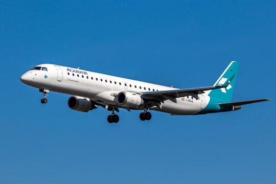 Air Dolomiti Embraer E195LR passenger plane landing on Frankfurt Airport. Frankfurt, Germany - September 11, 2019