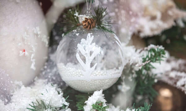 Christmas ornaments. Xmas tree decoration, white snowy baubles, holiday background,
