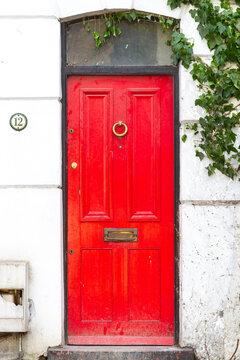 Red front door in London, UK