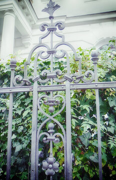 Wrouht iron fence in Renaissance style decorating the garden of a mansion