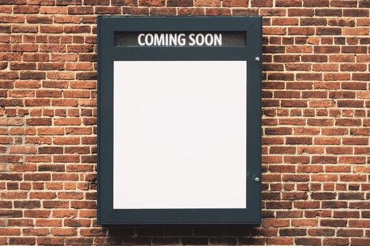 Blank white Coming Soon banner on brick wall, mockup