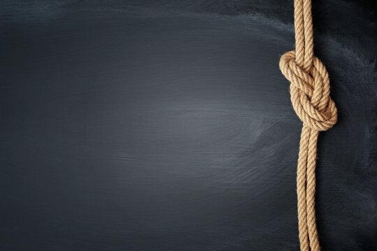 Ship rope knot on blackboard background