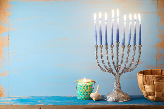 Jewish holiday Hanukkah concept with menorah on vintage background