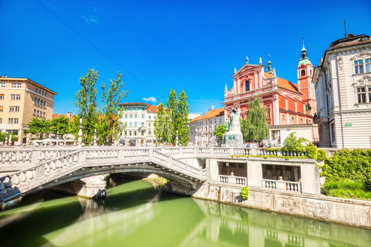 Ljubljana City Center during a Sunny Day overlooking the Triple Bridge and Beautiful Franciscan Church