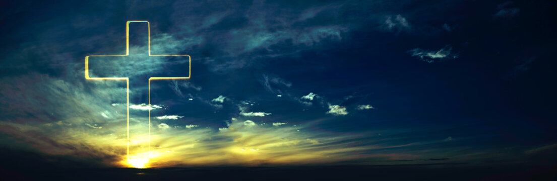 Silhouette of shining cross on sunset, sunrise background. Banner. Copy space. Easter, Ascension day concept. Church worship. Faith symbol. Gate to heaven. Eternal life of soul. Christianity gospel