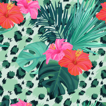 Tropical pattern with palm leaves and hibiscus. Jungle summer plant. Abstract leopard background. Vector floral illustration