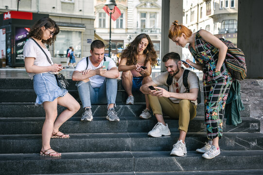 Group of friends using smartphones together. Young people addiction to new technology trends. Youth, new generation internet friendship concept. Emotional isolation and depresion