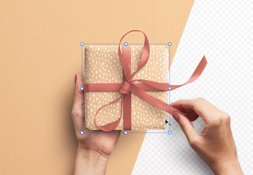Mockup of Hands Holding Gift Box with Ribbon