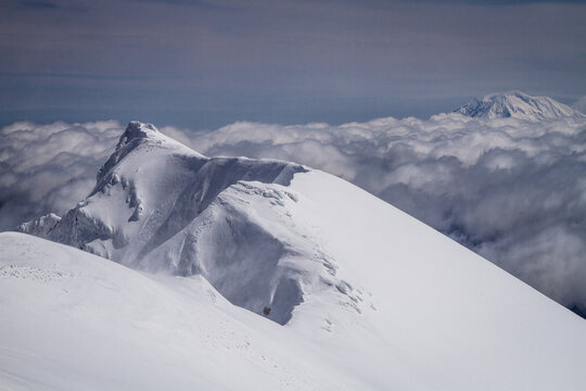 View of snow covered crater rim of Mount Saint Helens and Mount Adams