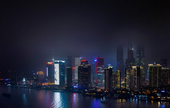 Scenic view of Shanghai skyline at night by Huangpu River
