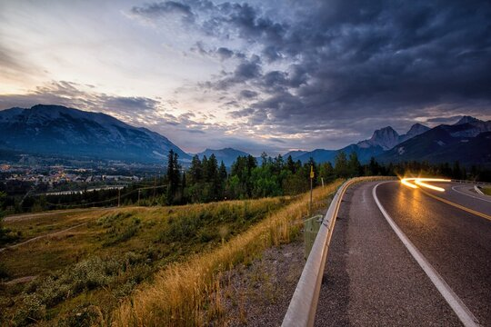 View of light trail on road with mountains in background
