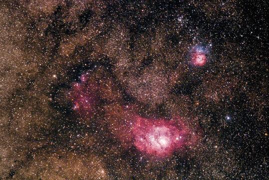 View of Lagoon Nebula resting below Trifid Nebula in Sagittarius constellation