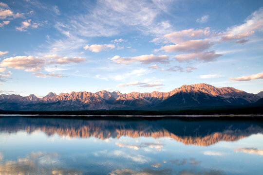 Scenic view of mountain range and Lower Kananaskis Lake during sunset