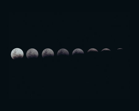 Closeup detailed shot of different phases of the moon in a dark night sky