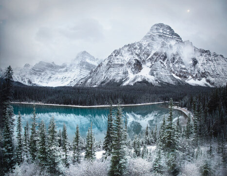 Waterfowl Lake, Banff National Park, Alberta Canada in winter. A winter landscape with a bright blue lake, snowy peaks and frosty trees. A winter wonderland.
