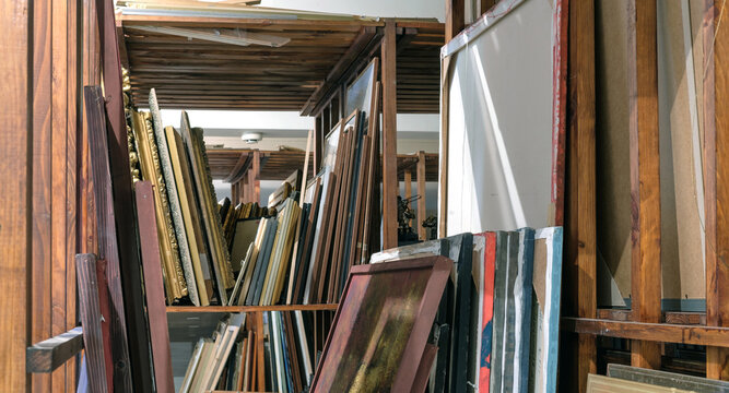 Wooden shelves full of pictures, Art gallery storage