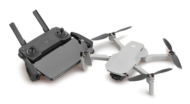 dji mavic mini drone and controller with smartphone path isolated on white