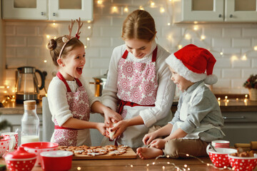 happy family mother and children bake christmas cookies