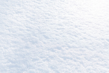 White snow winter texture. Christmas holiday background. Seasonal fresh white color snow nature backdrop wallpaper. First frost. Crisp shiny textured ice frosty snow on sunny day outdoors.