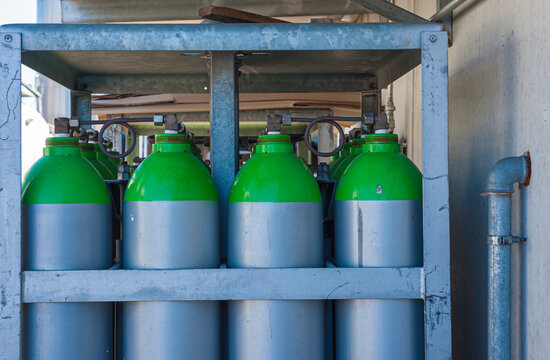 Gas industry, oxygen cylinders and pipes with valves.