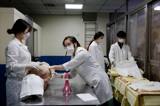 Park Bo-ram, a funeral director, cleans the body of a deceased at a funeral home in a medical center in Seoul