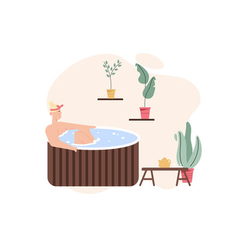 Happy woman in wooden bathtub, drinking tea at spa salon