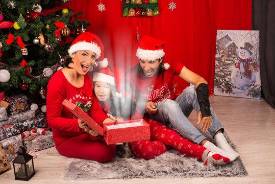 Amazed family of magic Christmas gift