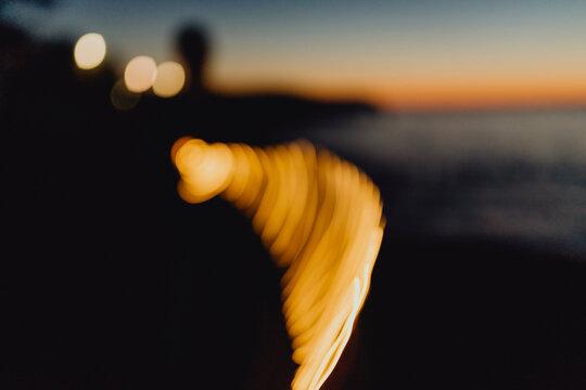 Bokeh lighting of a man by the beach