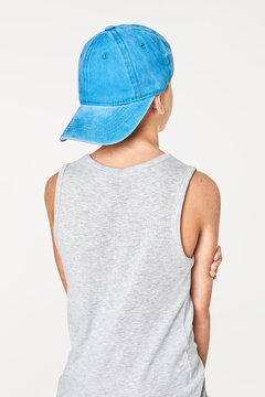 Back view boy's gray tank top with blue cap