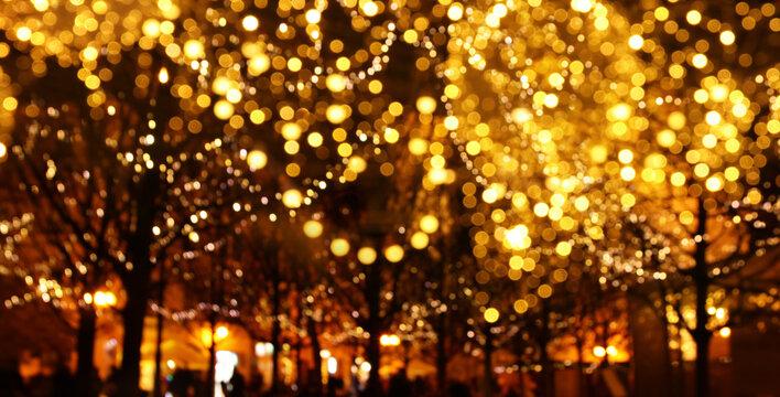 abstract background of christmas blurred defocused bokeh street lights