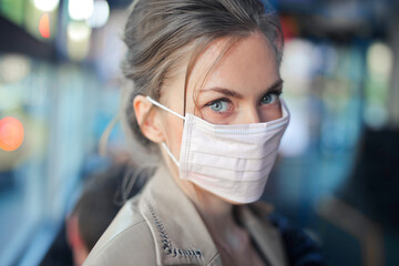 portrait of girl with mask on a bus