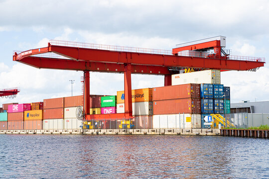 Tilburg, Netherlands - 28.06.2020: River barge terminal on dutch canal - new logistic place of loading containers to ships from Tilburg, Brabant to Rotterdam