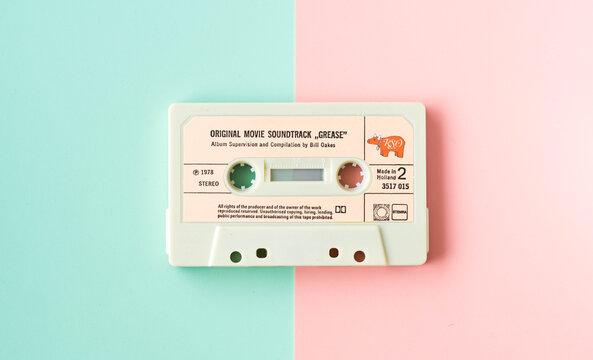 "Tilburg, Netherlands - 06.11.2019: original cassette with movie  soundtrack ""Grease"" from 1978. Illustrative editorial image."