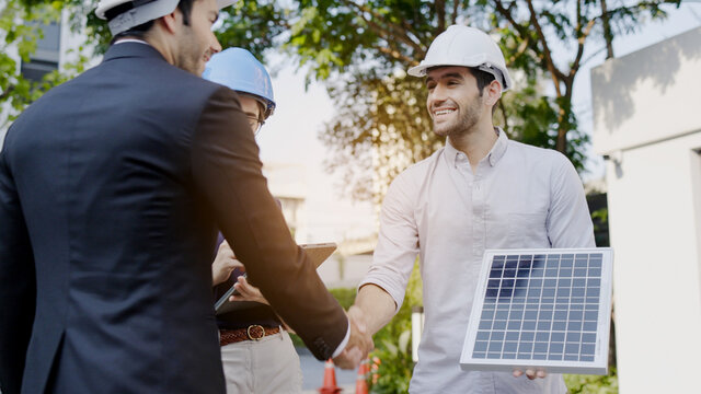 Electrical Engineer Technician Talk to business people to invest in install solar cells outside building or industrial factory. Collaboration on energy reduce for environment. Concept key worker
