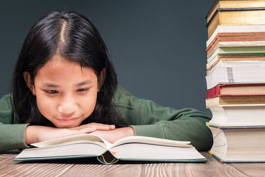 Child Intend to Read the Book