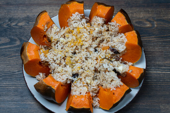 Stuffed roasted pumpkin, whole baked, filled with a mixture of rice, raisins and spices