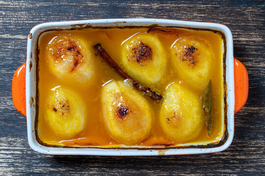Baked pears in orange juice, close up. Delicious dessert.