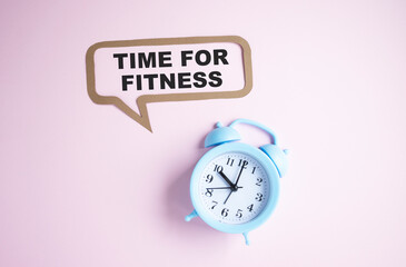 Text Time For Fitness isolated on pink background with alarm clock.