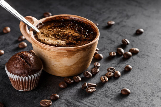 Coffee with milk cup and roasted beans.Coffee beans wallpaper. Coffee background. Side view.