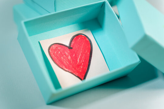Heart drawn inside a turquoise gift box Suitable for concepts like luxury gift, anniversary, Valentine's day, Mother's day or christmas