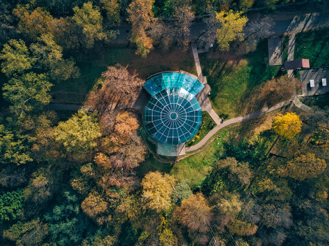 Drone view of structures amidst trees at Skitsky Ponds park
