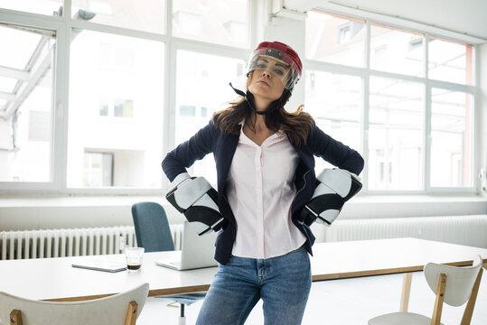 Portrait of businesswoman wearing ice hockey equipment