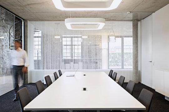Businessman walking in modern conference room