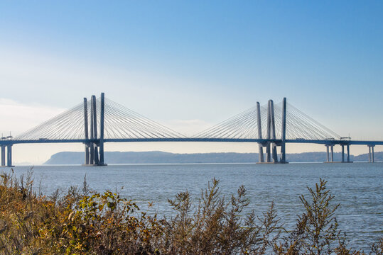Mario Cuomo Bridge in New York during Fall with foliage in the foreground.