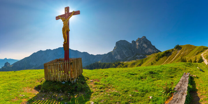 Christian cross with Jesus figurine against Aggenstein mountain, Allgaue Alps, Germany